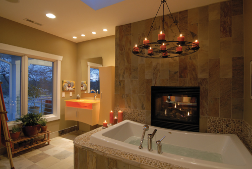 Fireplaces Can Be Used To Create The Feeling Of Luxury, Such As The One In  This Bathroom, With The Chandelier And The See Through Slate Fireplace.