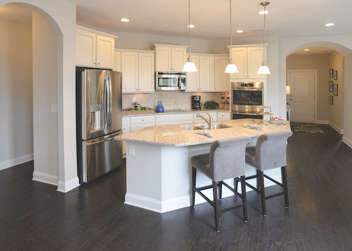 Open, centrally located kitchen by Epcon Communities