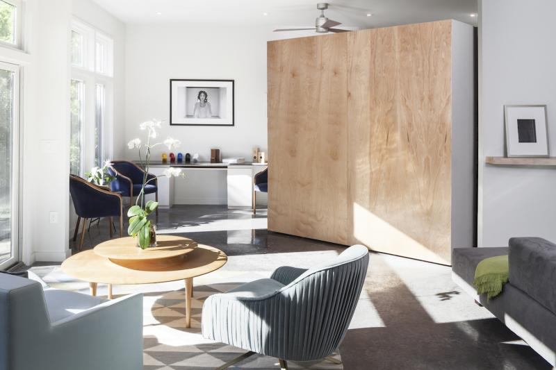 8 by 8 moveable wall separates the study from the living area