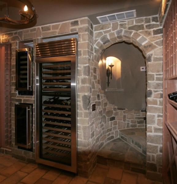 Wine cellar with roof tile floor and stone veneer walls