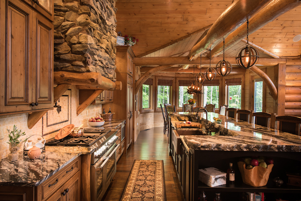 log cabin kitchen and family room by Golden Eagle & Timber Homes