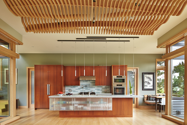 undulating ceiling panels over dining room