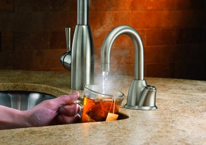 the hot100 instant hot water dispensing system from insinkerator is available in chrome or satin nickel finishes and includes an easy push button feature - Kitchen Sink Water Dispenser