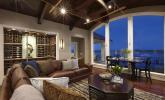 Coastal Mediterranean gathering room and wine cellar